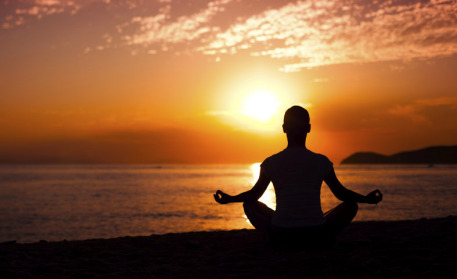 Man-Meditating-At-Sunset-01152015-457x279